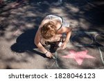 The Child Draws With Chalk. Th...
