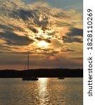 Sun Setting Over The Calm Sea...