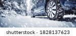 The car stopped on the roadside in winter blizzard. There is a very heavy snowstorm. Vehicle is covering with snow.