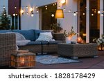 Summer evening on the patio of beautiful suburban house with lights in the garden garden