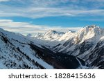 snowy mountains and forest at... | Shutterstock . vector #1828415636