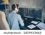 Small photo of Rear back behind view portrait of his he nice skilled busy geek guy typing php language C plus editing sql database source at modern industrial interior style concrete wall work place station