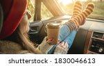 Woman In A Car In Warm Woolen...