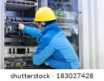 man connecting network cables... | Shutterstock . vector #183027428