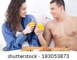 young couple having breakfast... | Shutterstock . vector #183053873