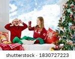 Child Decorating Christmas Tre...