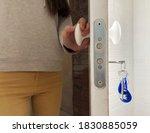 woman stands in the doorway... | Shutterstock . vector #1830885059