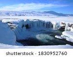 Frozen Waterfall Against Snow...