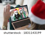 Woman In Santa Claus Hat Holds...