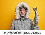 Puzzled Frozen Male Fisher Has...