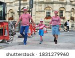 Small photo of Bath, UK - September 28, 2012: A family dress up as the character Wally from the British puzzle book Where's Wally by author and illustrator Martin Handford. Wally is know as Waldo in the US market.