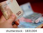 hand holding bunch of bills   Shutterstock . vector #1831304