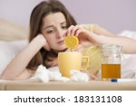 sick woman lying in bed with... | Shutterstock . vector #183131108
