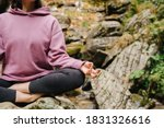 Young Woman Sitting Barefoot On ...