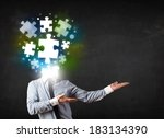 Stock photo character in suit with glowing puzzle head concept 183134390