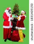 Small photo of Santa Claus and the Mrs. dressed in ppe, or personal protective gear, including gloves, masks and suits exchanging gifts under Christmas tree with removable green screen background.