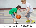 Two Boys Playing Basketball...