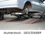 Car wheel repair shop outdoor ground . Seasonal winter tyre change at workshop. Vehicle tire repair, inspection and maintenance. Automotive garage with inflatable pneumatic air jacks. Copyspace text - stock photo