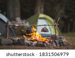 Camp Fire And Tea Pot Are...