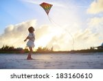 Little Girl Flying A Kite On...
