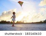 Little Girl Flying A Kite On...