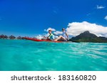 mother and son paddling at... | Shutterstock . vector #183160820