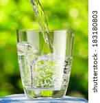 glass of water on nature...   Shutterstock . vector #183180803