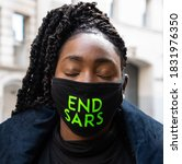 Small photo of London, UK. 11th Oct. 2020. Protesters are calling for the scrapping of police unit, known as Special Anti-Robbery Squad (SARS) over the squads incessant harassment and brutality of innocent Nigerians