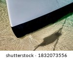 Bow Of A Catamaran In Shallow...