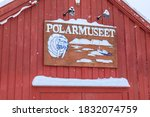 Red Wooden Building With A...