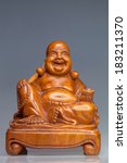 Wooden Statue Of A Seated...