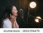 Young Beautiful Woman Singing...