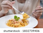 close up on woman eating... | Shutterstock . vector #1832739406