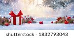 Small photo of Christmas Holiday Background With Gift And Decorations On A Sunny Background