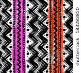 Vector seamless ethnic pattern hand painted with bold zigzag brushstrokes and stripes in bright colors  - stock vector