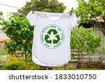 Small photo of T shirt on washing line with circular economy textiles icon, make, use, reuse, swap, donate, recycle with eco clothes recycle icon sustainable fashion concept