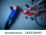 Little Boy With Toys In Studio