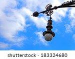Old Street Lamp Over Blue Sky...