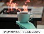 White Mug Of Tea On The Arm Of...