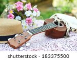 Brown Ukulele With Lovely Hat...