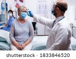 Doctor Wearing Protective Mask...