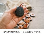 Small photo of rune stone good luck and riches talisman with runescript