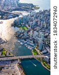 Small photo of Aerial view of False Creek in Downtown Vancouver, British Columbia, Canada. Modern City viewed from above. Bright Sunny Day