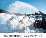 A Snow Plough Blowing Piles Of...