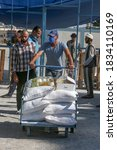 Small photo of Palestinians come to receive food aid from a United Nations Relief and Works Agency (UNRWA) distribution centre in the Khan Younis camp for Palestinian refugees in Gaza Strip, on 15 October 2020.