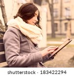 young woman sitting with tablet ... | Shutterstock . vector #183422294