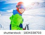 Portrait Of Cute Happy Skier...