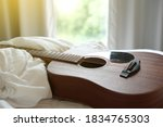 Acoustic Guitar On White Cloth...