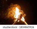 Two Burning Torches On A Dark...