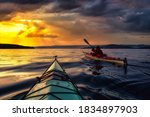 Adventure Man On A Sea Kayak Is ...